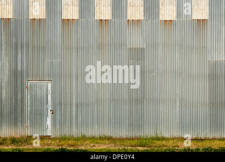 Door and the corrugated wall ready for your art work - Stock Photo