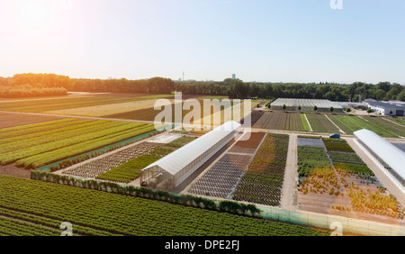 View of fields and greenhouses, Munich, Bavaria, Germany - Stock Photo