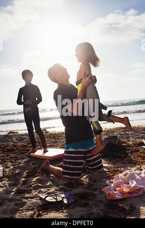 Father and children on beach, Encinitas, California, USA - Stock Photo