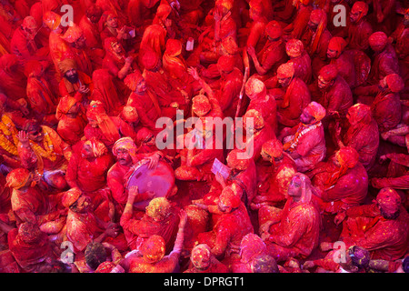 Men from Nandgaon & Barsana sit face to face in a Samaaj (a community gathering) during the festival of Holi, Uttar - Stock Photo