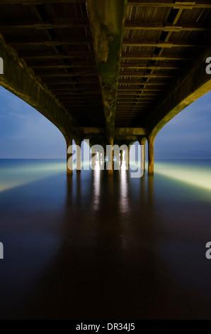 Under Brighton Pier, Brighton, England, UK. - Stock Photo