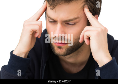Close-up of a handsome young man with headache - Stock Photo