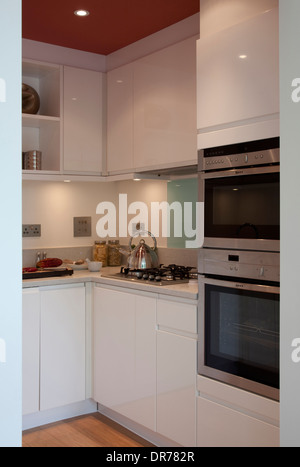 Hob and oven in fitted corner unit in modern kitchen stock for Small fitted kitchens