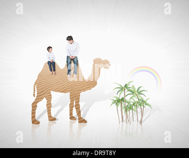 a kid and father with illustrated camel - Stock Photo