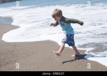 Cute little boy having fun at beach - Stock Photo