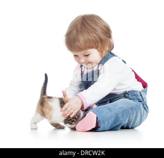 happy kid playing with cat kitten - Stock Photo
