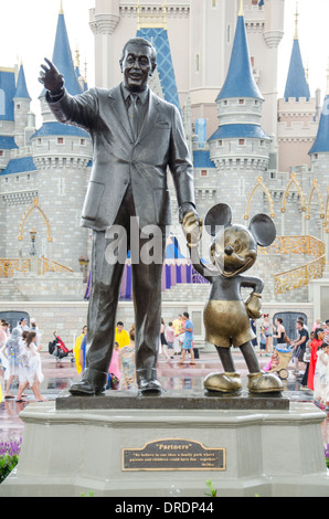Statue Of Walt Disney And Mickey Mouse In Front Of