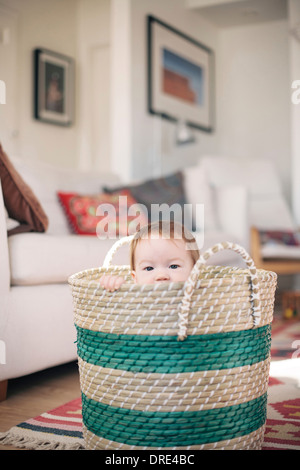 Baby sitting in basket - Stock Photo