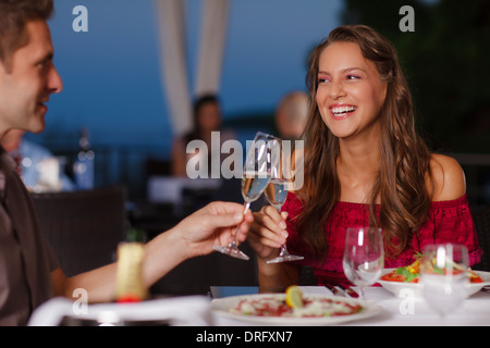 Young couple toasting champagne flutes, Dubrovnik, Croatia - Stock Photo