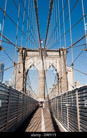A view from the sidewalk of Brooklyn bridge New York under repair - Stock Photo