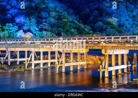 Arashiyama, Kyoto, Japan at Togetsukyo Bridge during the annual autumn light up. - Stock Photo