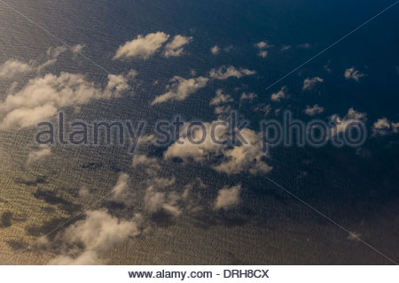 Aerial view flying over the East China Sea en route from Shanghai, China to Tokyo, Japan. - Stock Photo