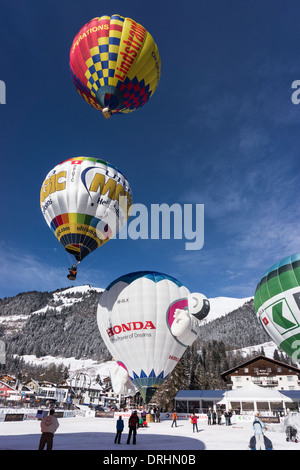 Hot-Air balloons lifting up. Chateau d'Oex, Switzerland. - Stock Photo