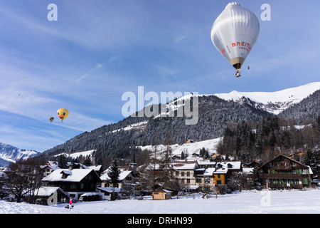 Balloons flying over Chateau d'Oex, Switerland - Stock Photo