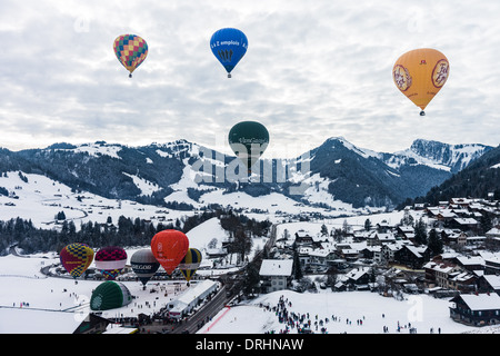 Group of balloons flying over Chateau d'Oex, Switzerland - Stock Photo