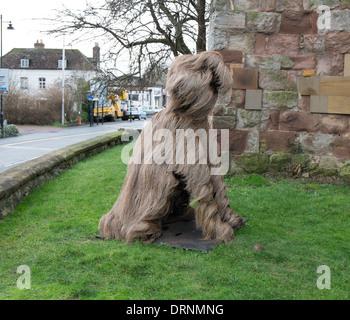 Fluffy dog in the grounds of church in Upton upon Severn, Worcestershire, UK - Stock Photo