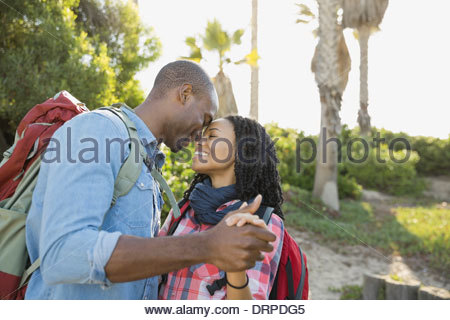 Romantic couple dancing outdoors - Stock Photo