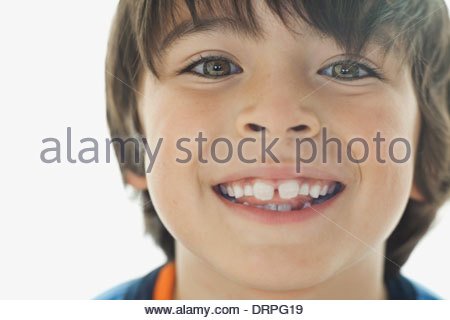 Close-up portrait of cute boy smiling - Stock Photo