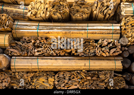Timber planks, stacked to become seasoned wood at Interlaken in the Bernese Oberland, Switzerland - Stock Photo
