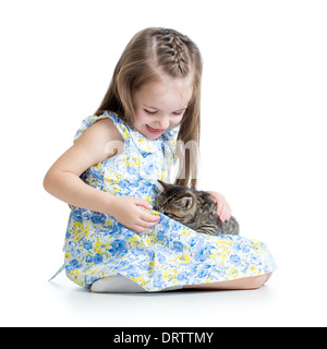 kid girl playing with cat kitten - Stock Photo