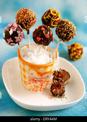 Chocolate cake pops with cherries. Recipe available. - Stock Photo
