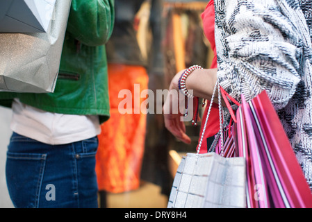 Women with shopping bags window shopping - Stock Photo