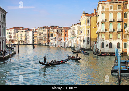 VENICE- 4 FEBRUARY 2100: Four gondolas transporting tourists  in the canal Grande perform at the most famous European - Stock Photo