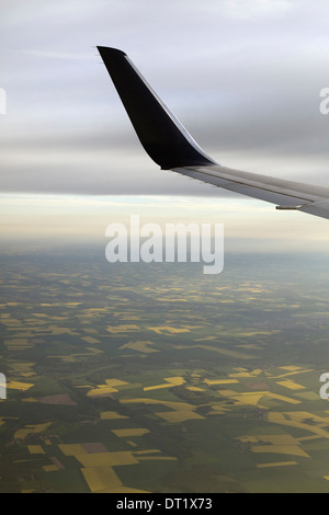The winglet or wing tip of an aircraft viewed from the passenger window - Stock Photo