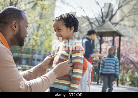 A family parents and two boys spending time together - Stock Photo
