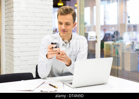 Man desk cell phone calling computer - Stock Photo