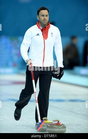 Sochi, Russia. 10th February 2014. David Murdoch (GBR) tidies the rink at the end of the match. Mens Curling - Iceberg - Stock Photo
