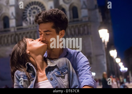 Young couple kissing at night, Paris, France - Stock Photo
