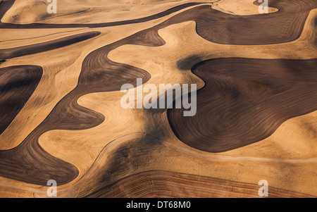Farmland landscape, with ploughed fields and furrows in Palouse, Washington, USA. An aerial view with natural patterns. - Stock Photo