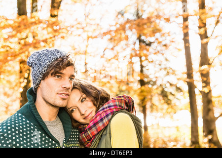 Woman with head on man's shoulder - Stock Photo