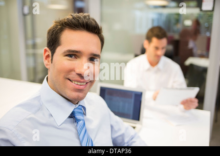 Portrait of Smiling Businessman in office, looking camera - Stockfoto