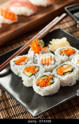 Healthy Japanese Vegetable Maki Sushi Roll with Rice and Fish - Stock Photo