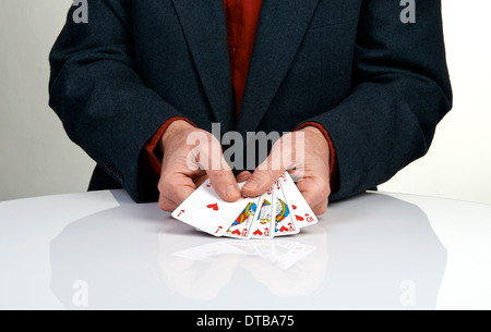 A royal straight flush playing cards poker hand in hearts - Stock Photo
