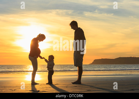 Family and toddler son playing on beach at sunset, San Diego, California, USA - Stock Photo