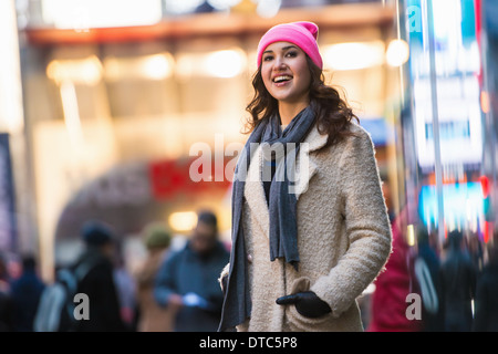 Young female tourist exploring streets, New York City, USA - Stock Photo