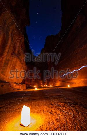 Lighting The Path of the Siq, Petra, Jordan - Stock Photo