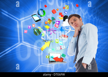 Composite image of thoughtful businessman with hand on chin - Stock Photo