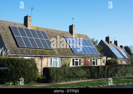 Solar photovoltaic panels on 1930s houses. UK, 2014. - Stock Photo