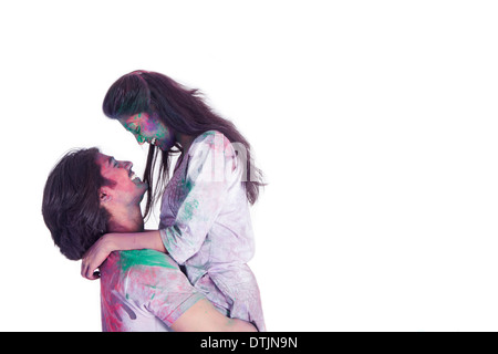 Couple playing holi festival - Stock Photo