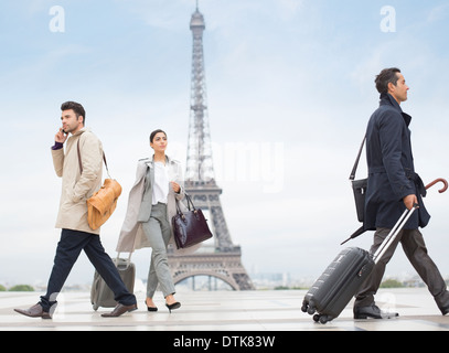 Business people walking near Eiffel Tower, Paris, France - Stock Photo
