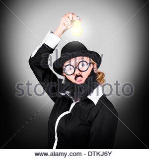 Creative business man holding light bulb above head. Bright innovation idea - Stockfoto