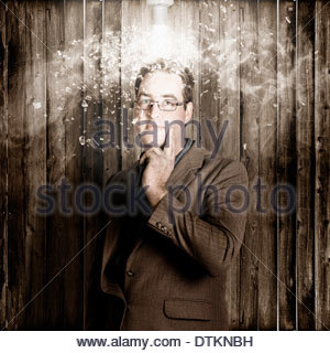 Idea concept of a creative business man brainstorming underneath a bright light bulb with explosive vision. Creativity - Stock Photo