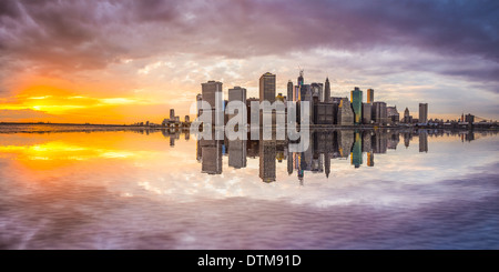 New York City Financial District in Lower Manhattan from across the East River. - Stock Photo