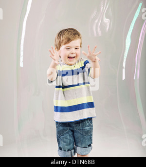 Little cute boy playing a soap bubbles - Stock Photo