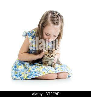 kid girl playing with Scottish kitten - Stock Photo