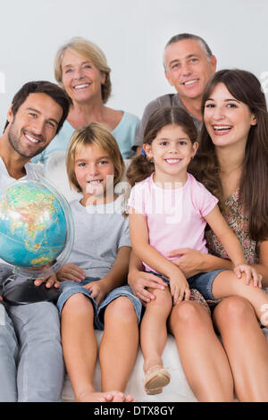 Happy family on the couch - Stock Photo